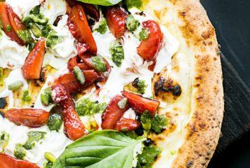 pepperoni-pizza-with-basil-leaves-1260968